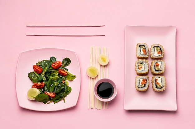 Flat lay flexitarian diet with sushi and salad