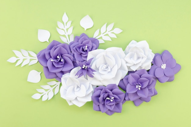 Flat lay floral arrangement on green background