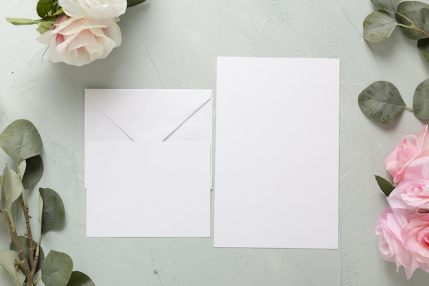 Flat lay of floral wedding invitation with copy space