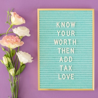 Flat lay flowers arrangement with message Premium Photo