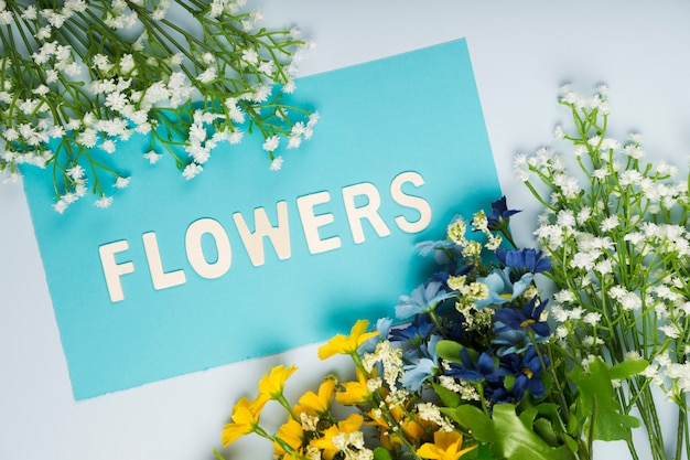 Flat lay flowers bouquet with greeting card