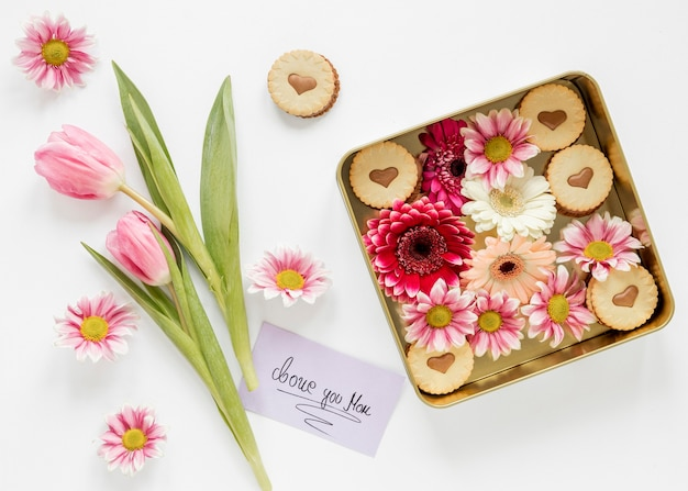 Flat lay flowers and card arrangement
