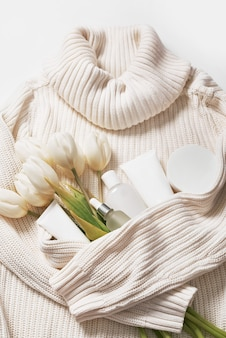 Flat lay flowers and cosmetics. natural care cosmetics and spa.