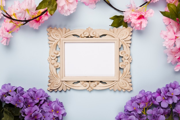 Flat lay flowers frame on table