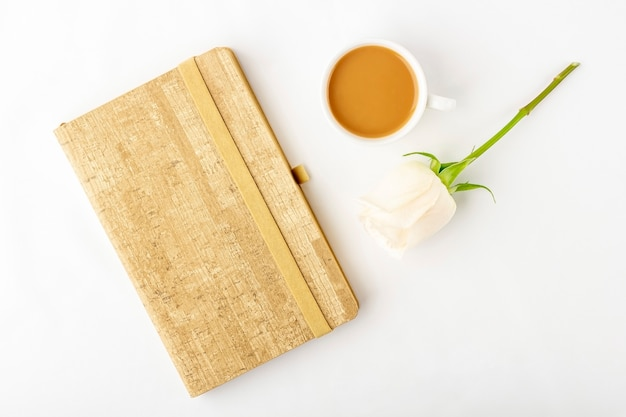 Flat lay flowers romantic composition. morning coffee mug for breakfast
