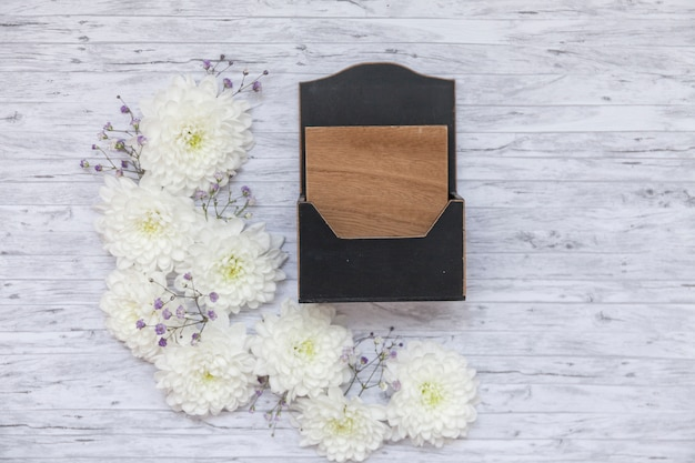 Flat lay of flowers and wooden flower pot