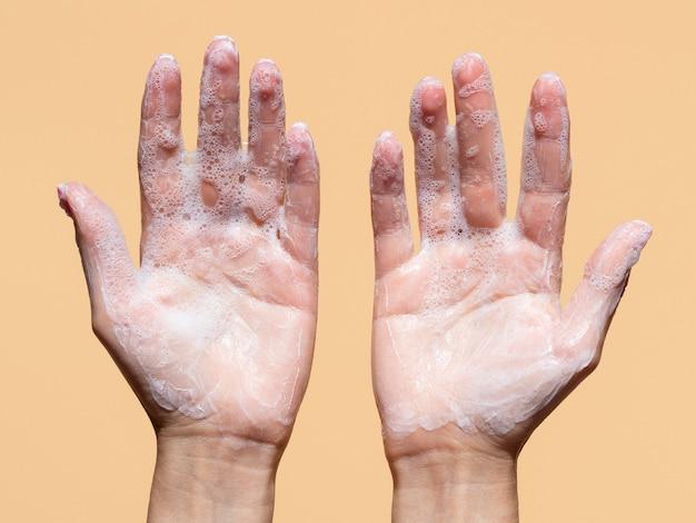 Flat lay of foamy hands from soap
