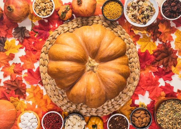 Flat lay food arrangement with big pumpkin