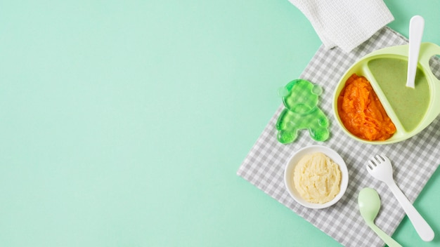 Flat lay food frame on green background
