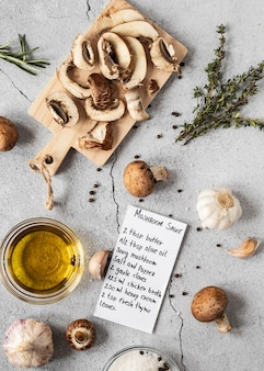 Flat lay of food ingredients with mushrooms and oil