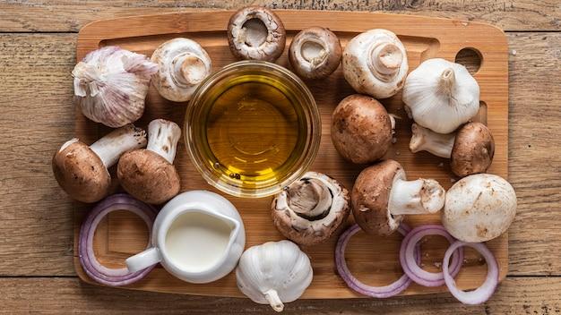 Flat lay of food ingredients with mushrooms