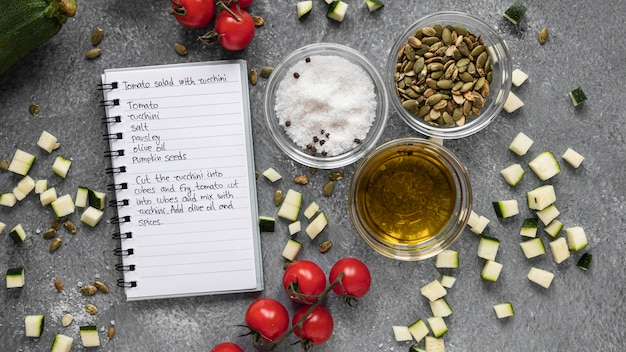 Flat lay of food ingredients with notebook