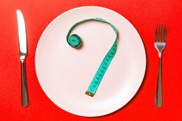 Flat lay over fork, plate and measuring tape