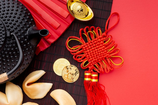 Flat lay of fortune cookies and teapot chinese new year