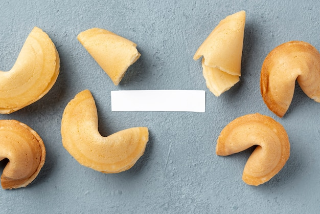 Flat lay fortune cookies with blank note