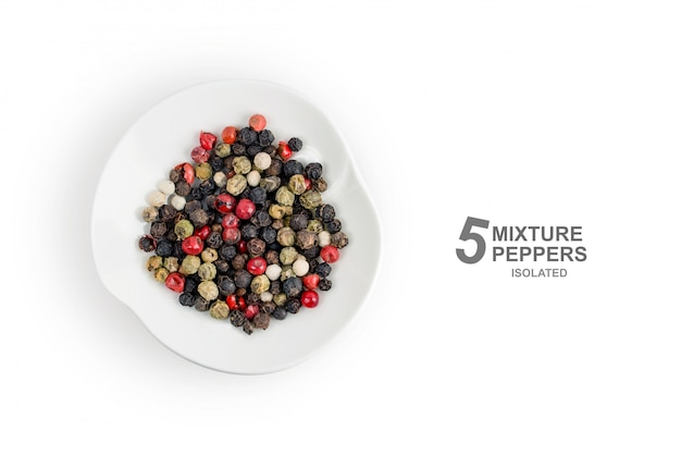 Flat lay. fragrant mixture of five types of random colored peppers in a plate isolated on white background. top view.