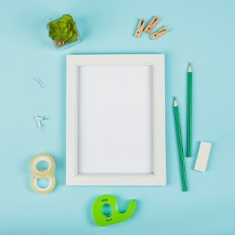 Flat lay of frame mock-up with blue background