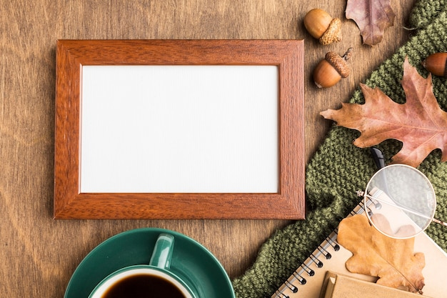 Flat lay of frame with autumn leaves and coffee