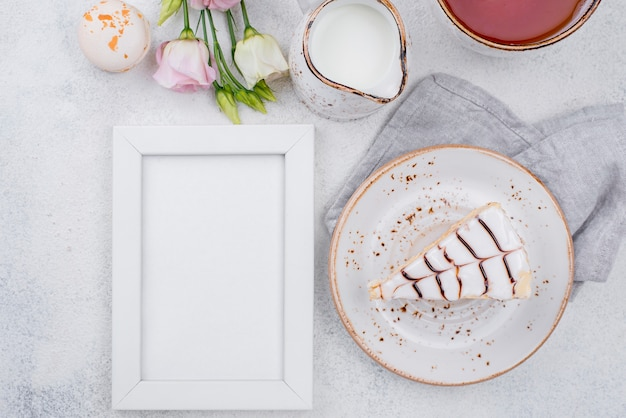 Flat lay of frame with cake and roses