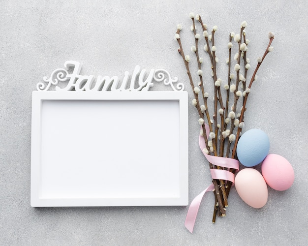 Flat lay of frame with easter eggs and flowers