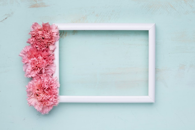 Flat lay of frame with floral concept