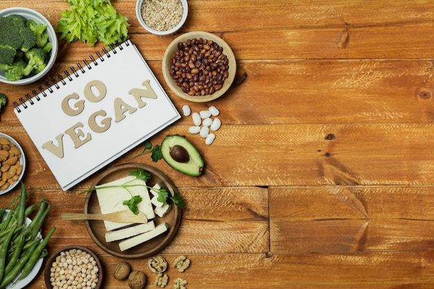 Flat lay frame with healthy food on wooden background