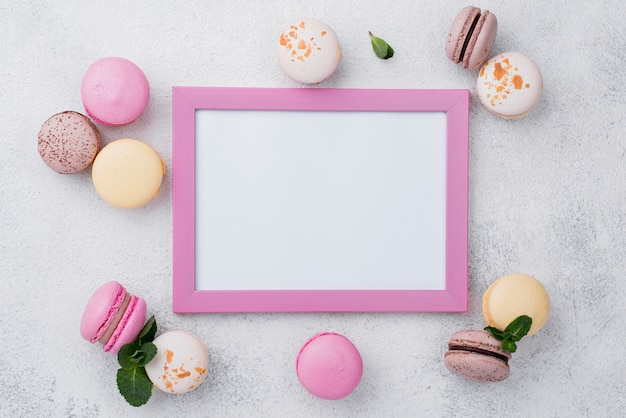 Flat lay of frame with macarons and mint
