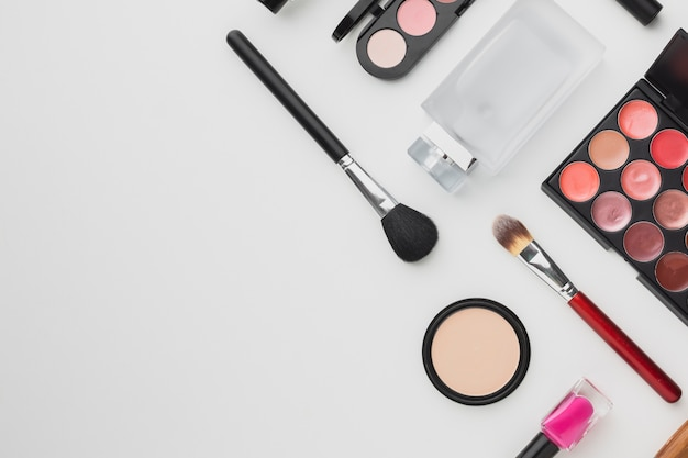Flat lay frame with make-up and perfume