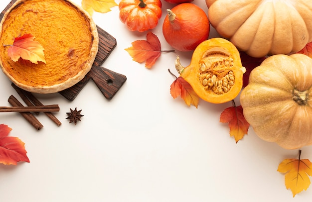 Flat lay frame with pumpkins and pie