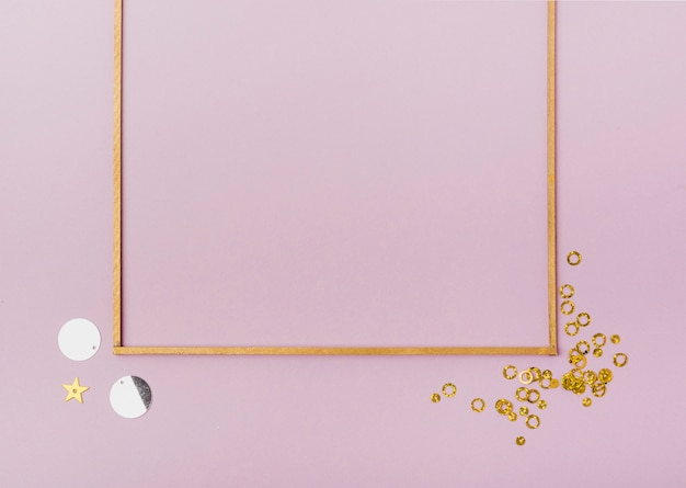 Flat lay frame with sequins and copy space