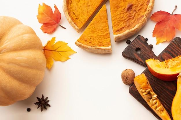 Flat lay frame with sliced pumpkin pie