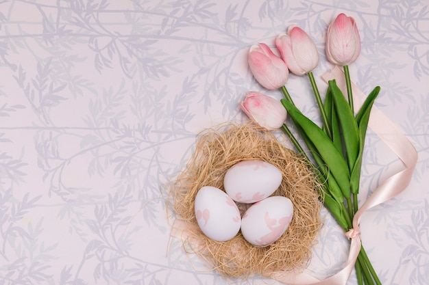 Flat lay frame with tulips and eggs