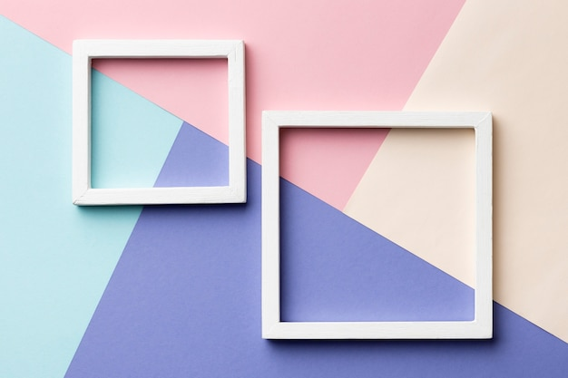 Flat lay frames on colorful background