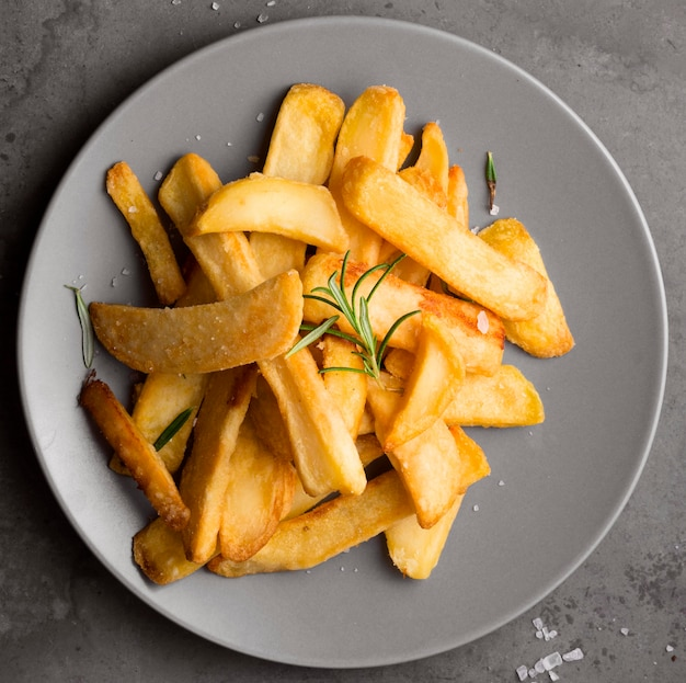Flat lay of french fries on plate