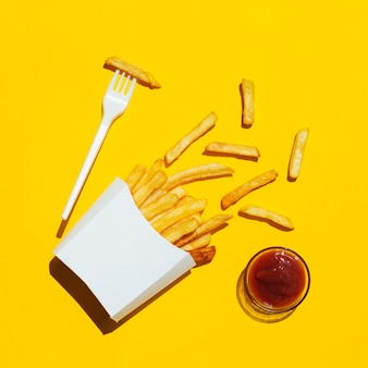 Flat lay of french fries with ketchup