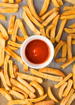 Flat lay of french fries with ketchup Free Photo