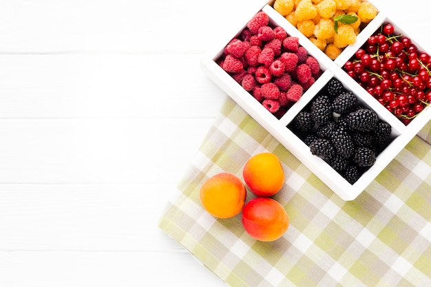 Flat-lay fresh berries on tablecloth  with copy space