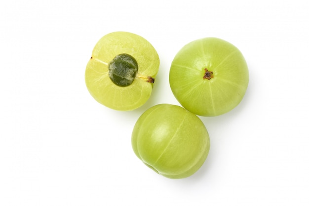 Flat lay of fresh indian gooseberry fruits with cut in half  isolated on white. clipping path.