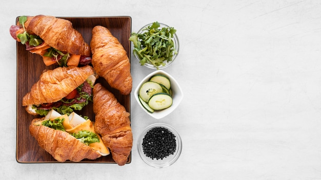 Flat lay fresh sandwiches arrangement with copy space