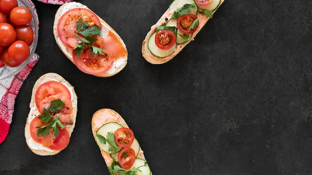 Flat lay fresh sandwiches composition with copy space