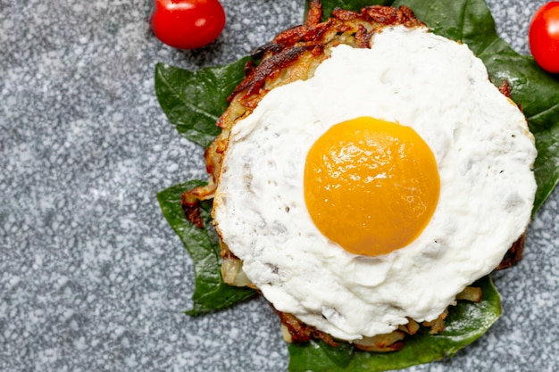 Flat lay fried egg breakfast with tomatoes