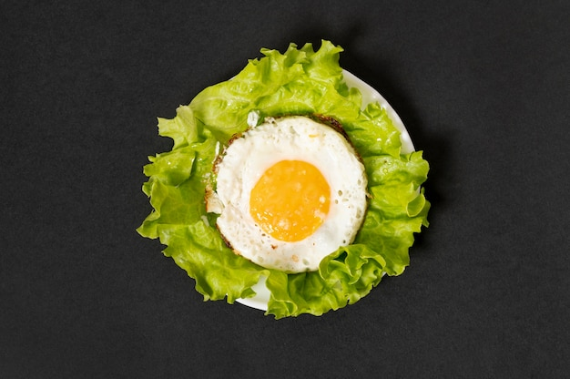 Flat lay fried egg on plain background