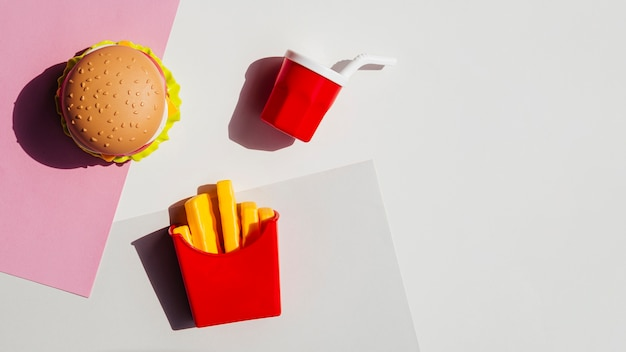 Flat lay of fries and hamburger replicas