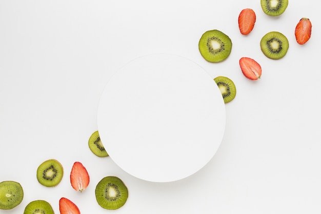 Flat lay of fruit assortement with plate
