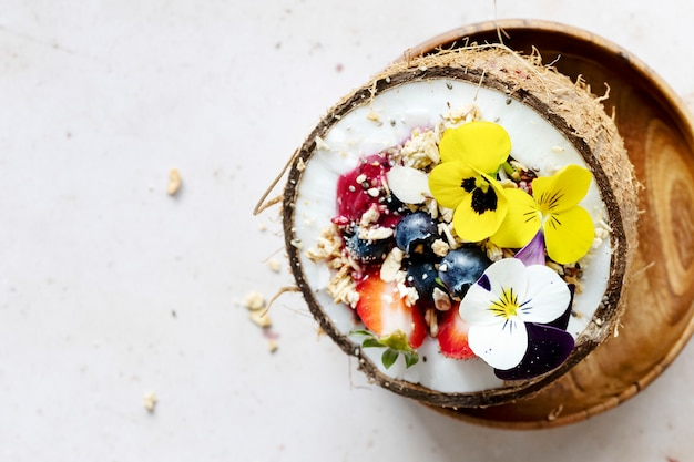 Flat lay fruits and grains in coconut shell tropical vibes