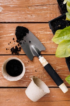 Flat lay gardening tools and flower pots