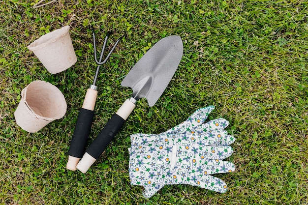 Flat lay gardening tools on the grass
