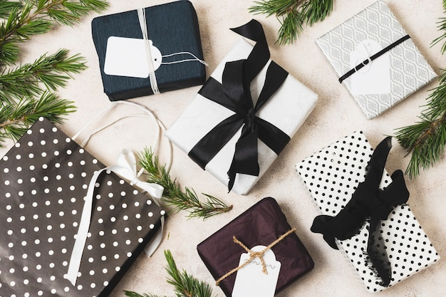 Flat lay of gift boxes with pine