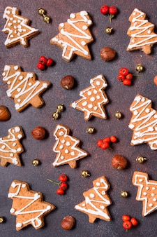 Flat lay of gingerbread cookies with red berries