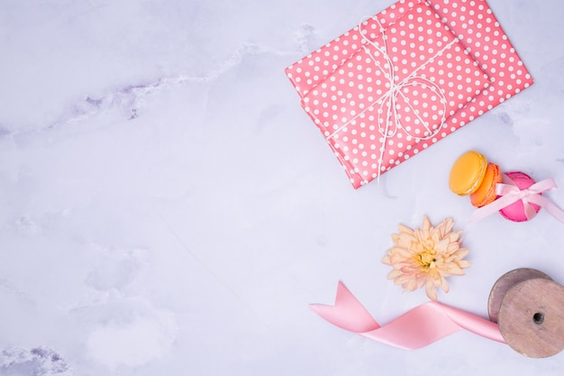 Flat lay girly birthday supplies on marble background